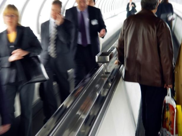 Business Travelers on Escalator