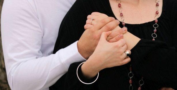 Couple Engaged w/ Ring